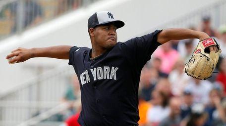 New York Yankees' Ivan Nova works against the
