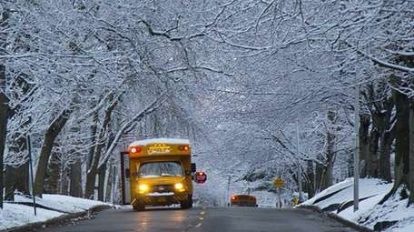 A school bus stops to pick up students