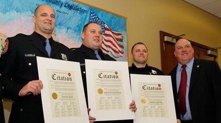 From left, Nassau First Precinct police officers Joseph