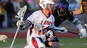 Connetquot attack Matt Oehl (13) drives from behind
