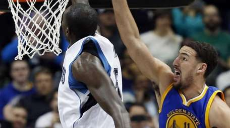Minnesota Timberwolves' Gorgui Dieng, left, of Senegal, blocks