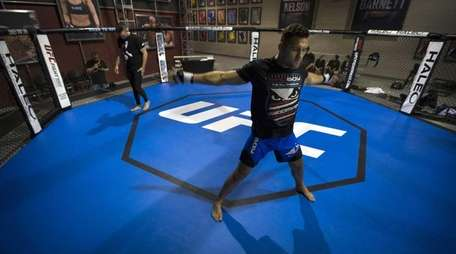 Chris Weidman loosens up before a workout at