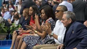 President Barack Obama, with his family, and Cuban