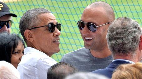 U.S. President Barack Obama speaks with former Yankees