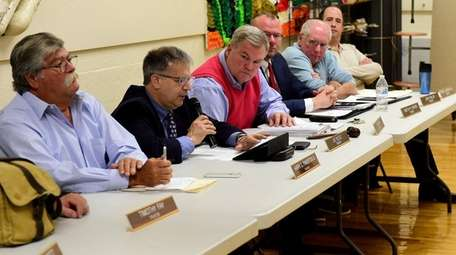 Members of the Bayville Village Board, including Mayor