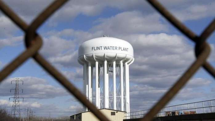 The Flint Water Plant water tower is seen,