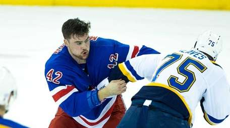 New York Rangers Dylan McIlrath (42) fights with