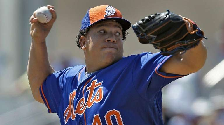 New York Mets' Bartolo Colon pitches to the