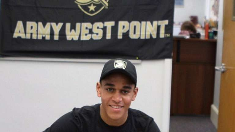 Oyster Bay High School runner Alex Tosi signs