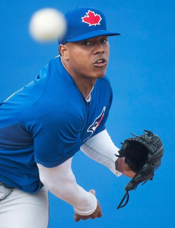 Toronto Blue Jays pitcher Marcus Stroman pitches