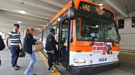 A NICE (Nassau Inter-County Express) bus picks