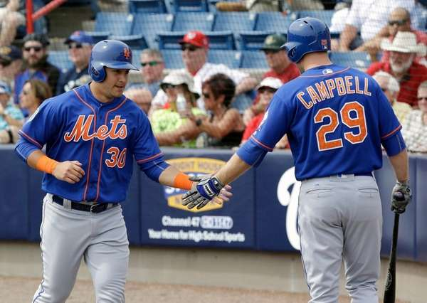 Michael Conforto receives congratulations from Eric Campbell