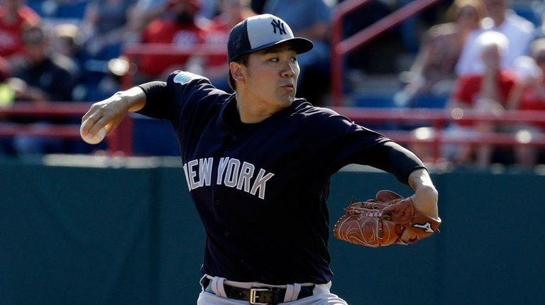 New York Yankees' Masahiro Tanaka pitches against the