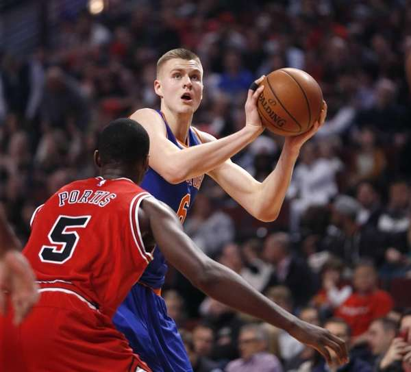 The New York Knicks' Kristaps Porzingis, right, looks