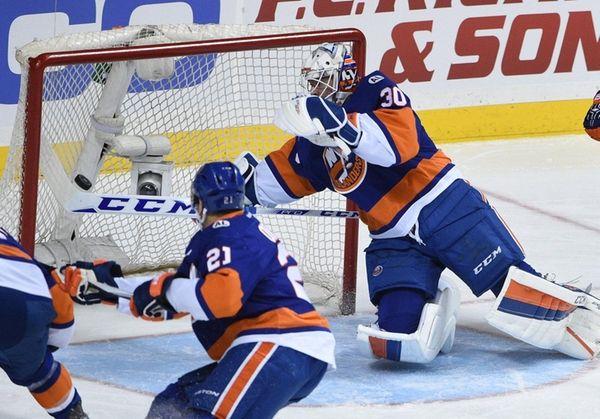 Islanders goalie J-F Berube makes a stick save