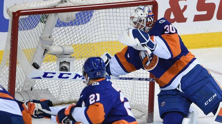 Islanders goalie J-F Berube makes a stick save