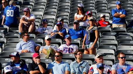 New York Giants fans look on from