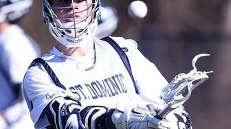 St. Dominic's Grant Galligan,# 28, fires a practice
