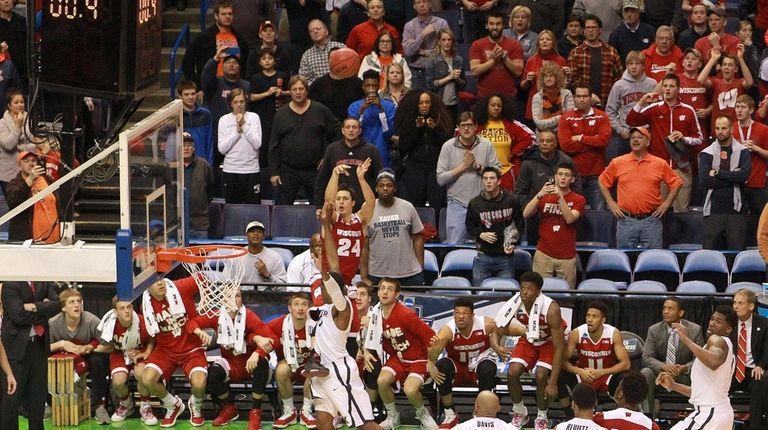 Wisconsin guard Bronson Koenig (24) takes the game-winning