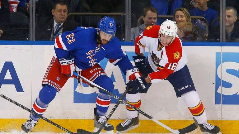 Keith Yandle of the New York Rangers defends