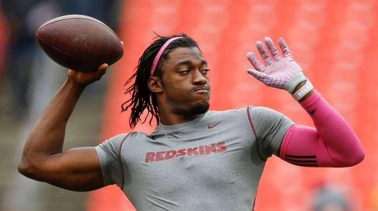 Washington Redskins quarterback Robert Griffin III warms up