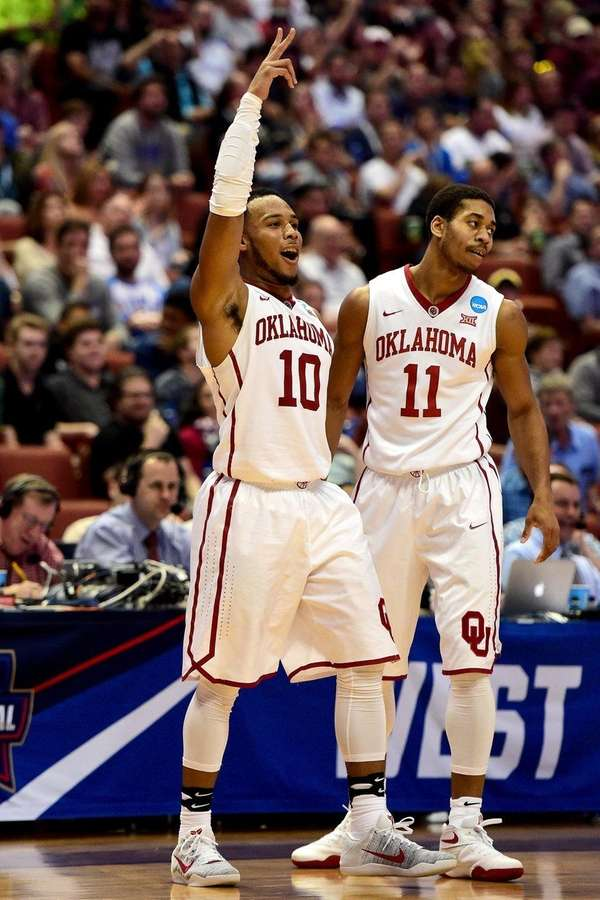 Jordan Woodard (10) celebrates with Oklahoma teammate Isaiah