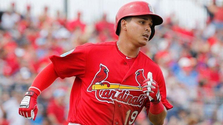 St. Louis Cardinals' Ruben Tejada heads for first