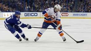Tampa Bay Lightning's Steven Stamkos, left, defends New