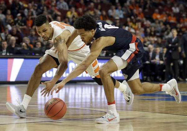 Syracuse's Michael Gbinije, left, and Gonzaga's Silas Melson