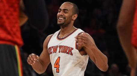 New York Knicks guard Arron Afflalo reacts after