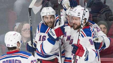 New York Rangers' Chris Kreider, center, celebrates with