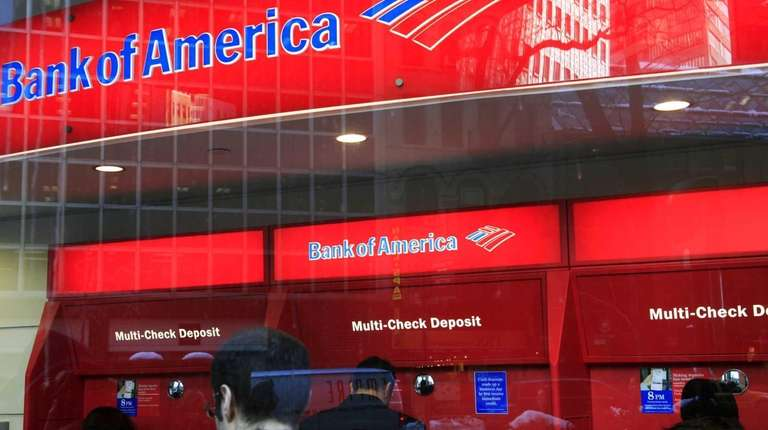 In this 2011 photo, Bank of America customers
