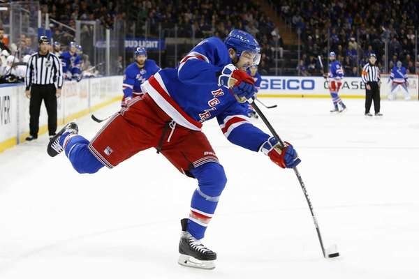 Rick Nash of the New York Rangers shoots