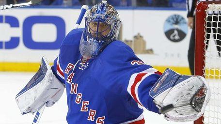 Henrik Lundqvist of the New York Rangers makes