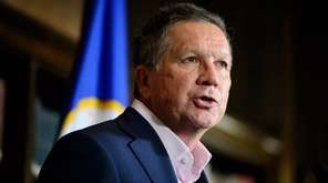 Republican presidential candidate John Kasich speaks at the