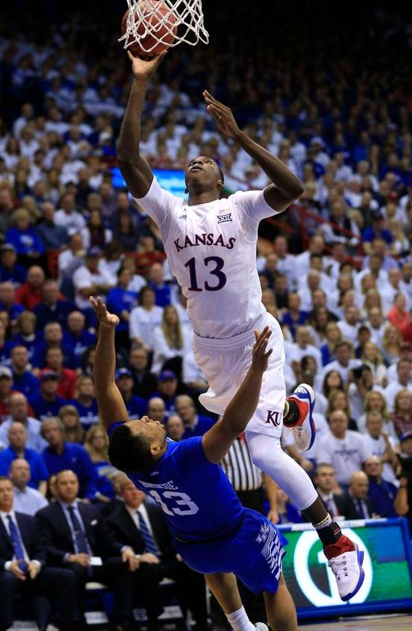 Kansas forward Cheick Diallo charges into Kentucky guard