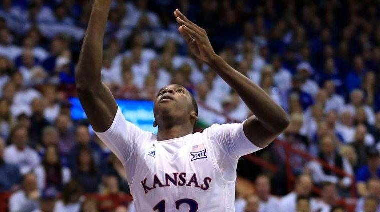 Kansas forward Cheick Diallo charges into Kentucky guard