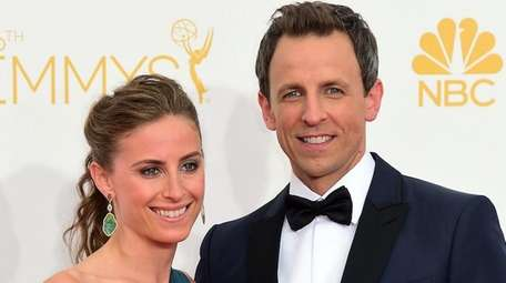 Comedian Seth Meyers and his wife, attorney Alexi