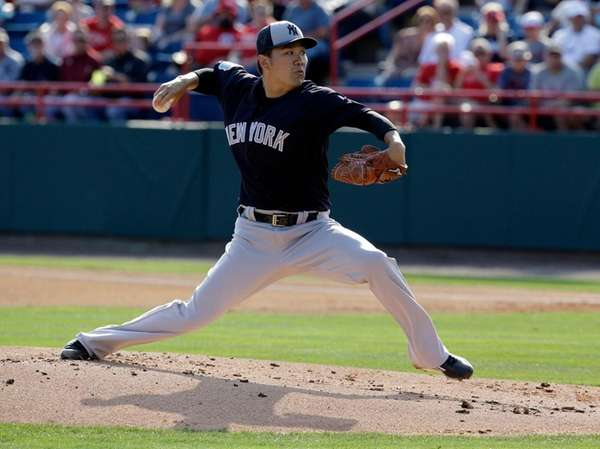 New York Yankees' Masahiro Tanaka pitches against the