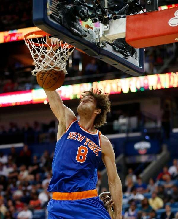 New York Knicks center Robin Lopez dunks in