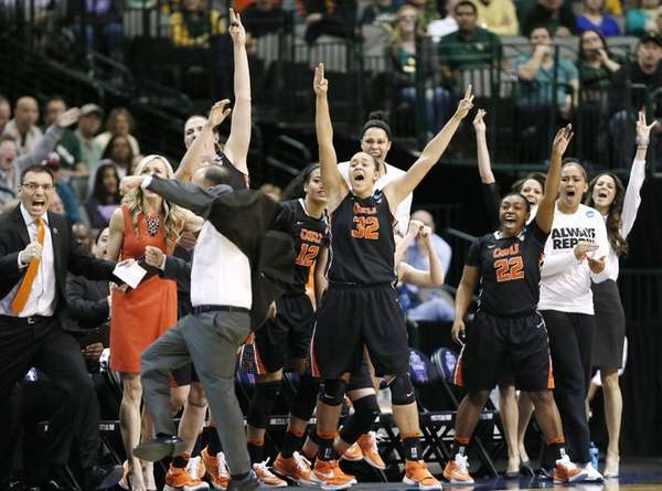 The Oregon State bench erupts on a