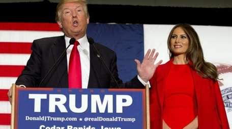 Republican presidential candidate Donald Trump, accompanied by his