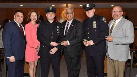 NYPD officers William Reddin of Lynbrook, left, and