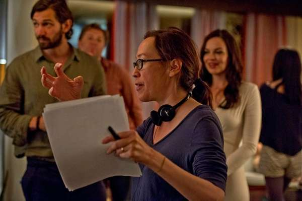 Director Karyn Kusama with actors Michiel Huisman, left,