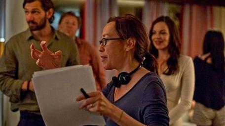 Director Karyn Kusama with actors Michiel Huisman, left,