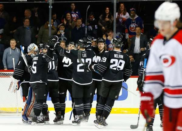 The New York Islanders celebrate after defeating
