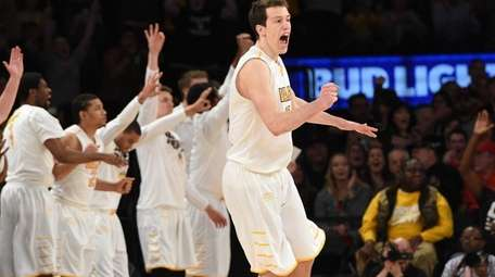 Valparaiso's David Skara reacts after he sinks a