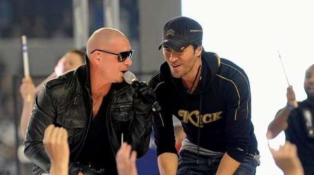 Pitbull, left, and Enrique Iglesias perform at the