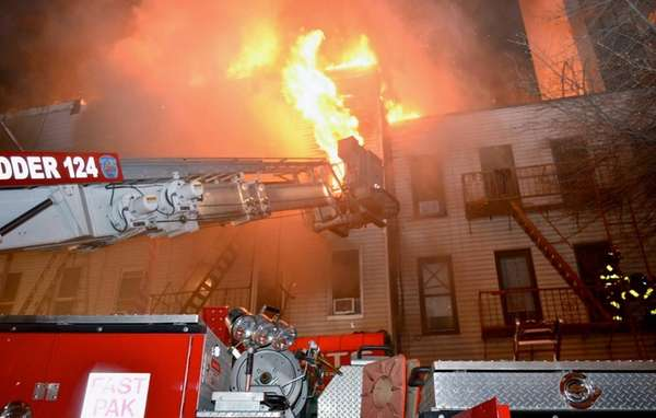 Firefighters respond to a raging, six-alarm fire on