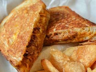 The Southern grilled cheese, topped with pulled pork